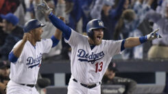 Two members of the L.A. Dodgers team celebrate their victory.