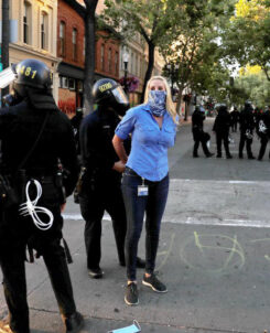 photo of CBS reporter Katie Nielson being detained by police
