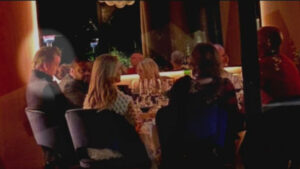 Photo of Governor Newsom without a mask eating at a table in a restaurant with other people