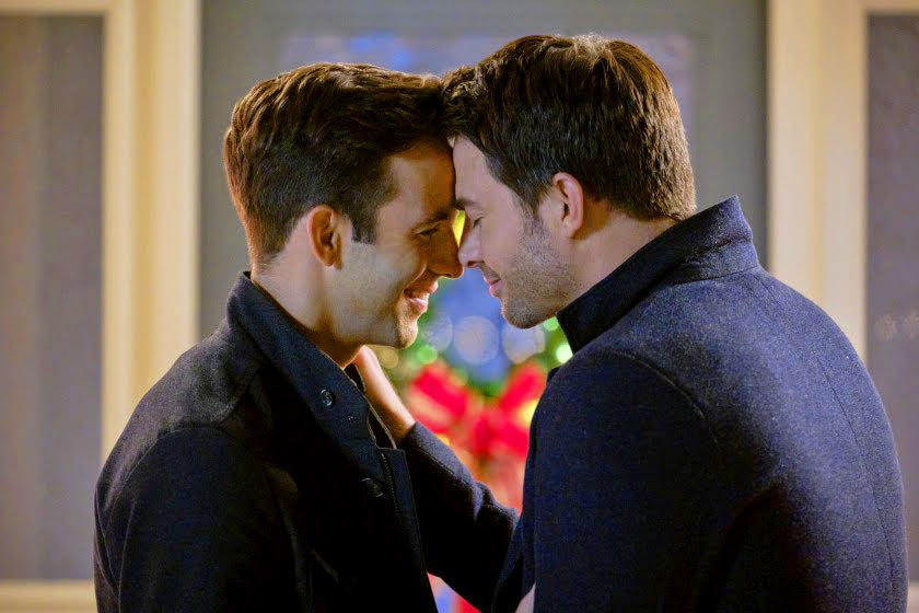 Image of two men kissing from The Christmas House