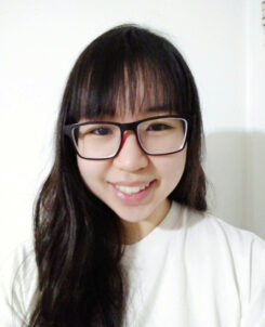 Cat Tang, who is discussing her poetry, smiling