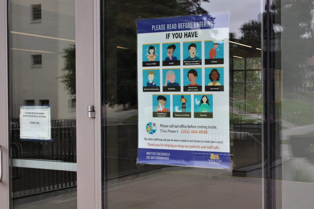 A sign posted in Whittier College about COVID-19 symptoms.